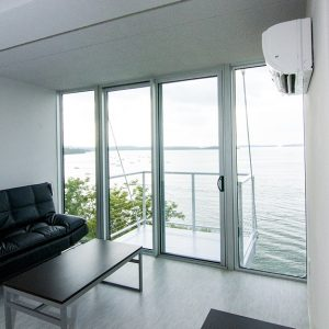 Living Room and Door to Balcony with Lake View